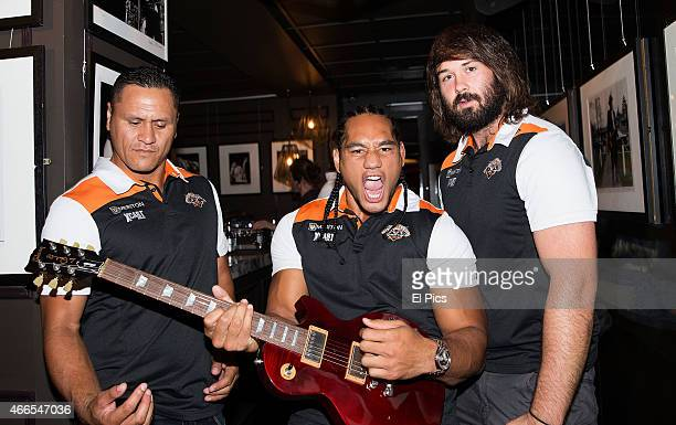 David Kidwell Martin Taupau and Aaron Woods of the Wests Tigers NRL team pose during the Gibson Exhibition on March 5 2015 in Sydney Australia