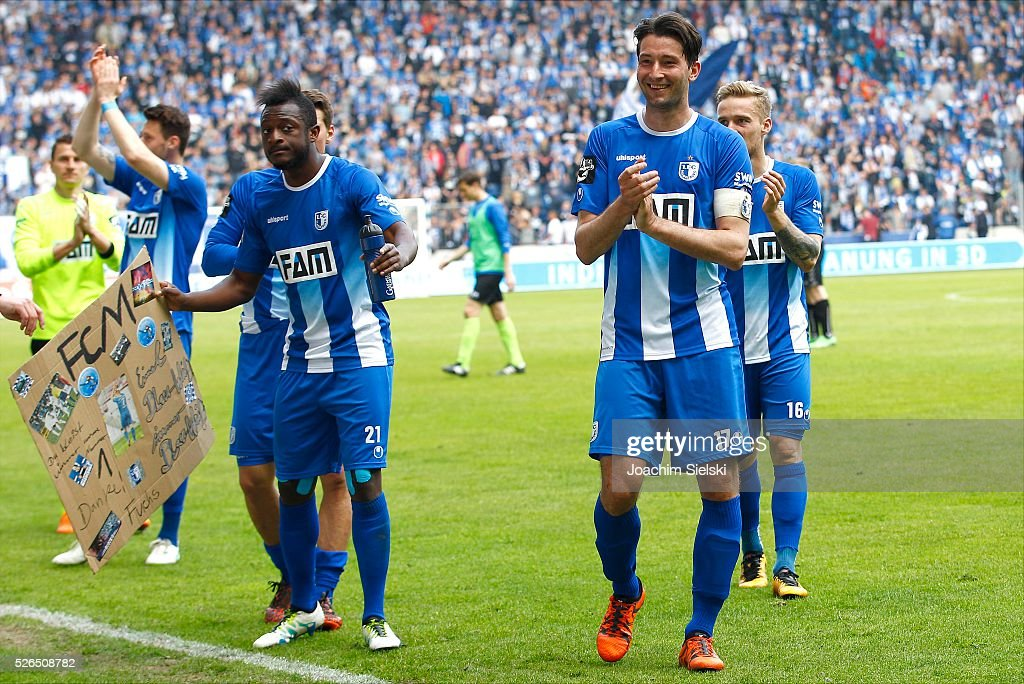 David Kinsombi, Marius Sowislo and Nils Butzen of Magdeburg celebration after the Third League match between 1. FC Magdeburg and SG Sonnenhof-Grosssaspach at MDCC-Arena on April 30, 2016 in Magdeburg, Germany.