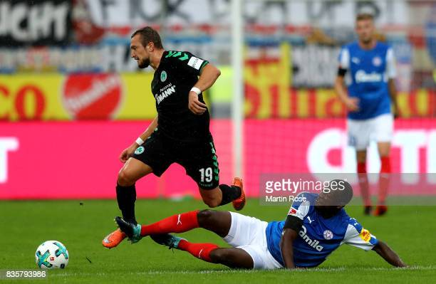 David Kinsombi of Kiel and Veton Berisha of Greuther Fuerth battle for the ball during the Second Bundesliga match between Holstein Kiel and SpVgg...