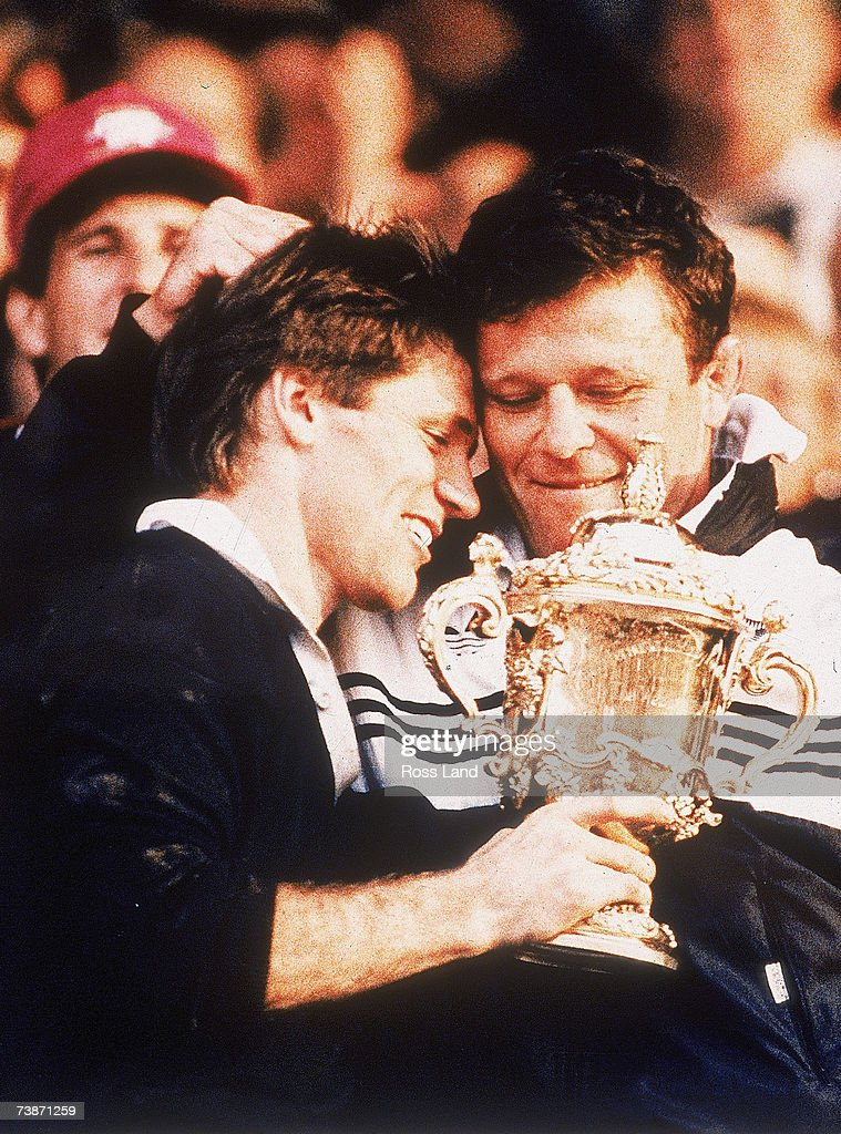 David Kirk and Andy Dalton of New Zealand hold the Willam Webb Ellis Trophy after the 1987 Rugby World Cup Final match between New Zealand and France...