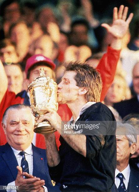 David Kirk of New Zealand kisses the Willam Webb Ellis Trophy after the 1987 Rugby World Cup Final match between New Zealand and France at Eden Park...