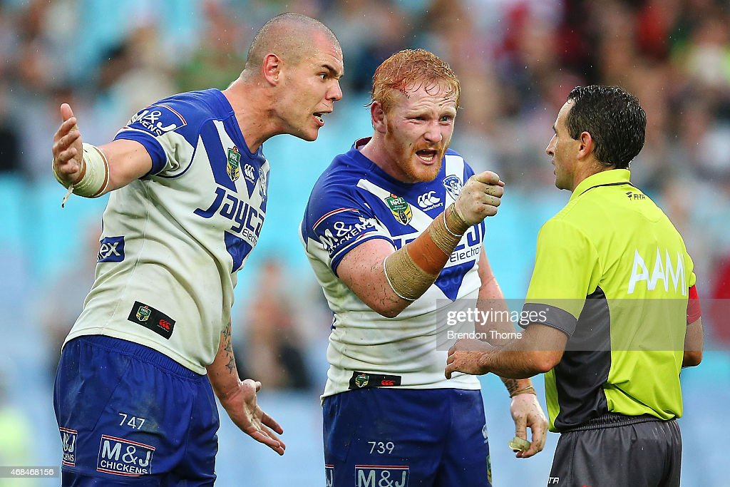 David Klemmer and James Graham of the Bulldogs confront referee Gerard Sutton after awarding the Rabbitohs a late penalty during the round five NRL...
