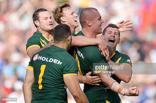 David Klemmer of Australia celebrates scoring a try with team mates during the Four Nations match between the Australian Kangaroos and Samoa at WIN...