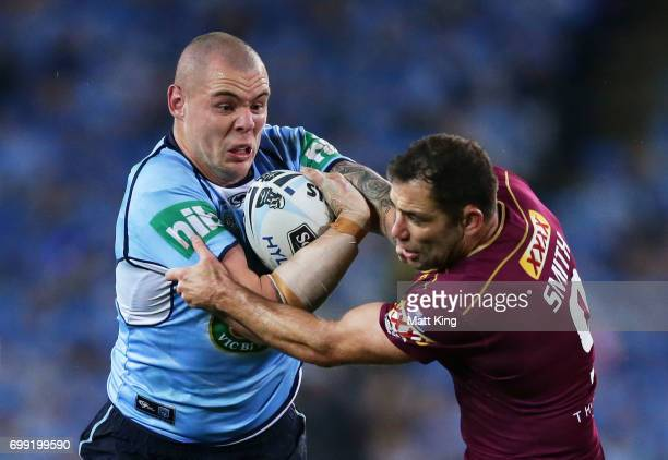 David Klemmer of the Blues is tackled by Cameron Smith of the Maroons during game two of the State Of Origin series between the New South Wales Blues...