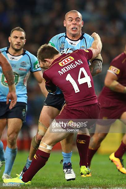 David Klemmer of the Blues is tackled by Michael Morgan of the Maroons during game one of the State Of Origin series between the New South Wales...