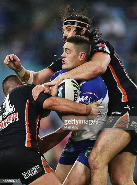 David Klemmer of the Bulldogs is tackled during the round 24 NRL match between the Canterbury Bulldogs and the Wests Tigers at ANZ Stadium on August...