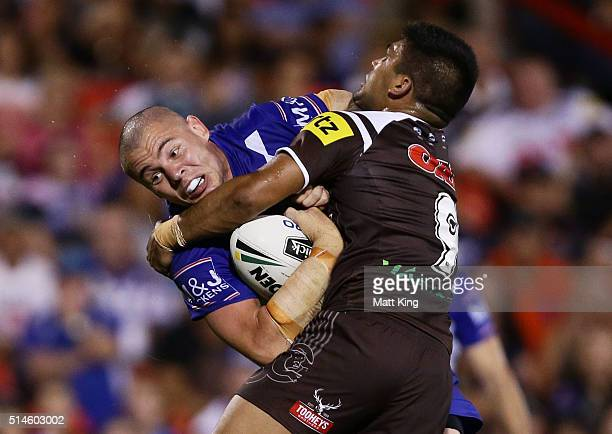 David Klemmer of the Bulldogs is tackled during the round two NRL match between the Penrith Panthers and the Canterbury Bulldogs at Pepper Stadium on...