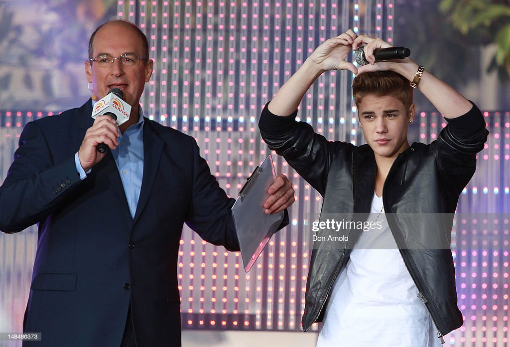 David Koch introduces Justin Bieber during his performance on the Sunrise program at The Overseas Passenger Terminal on July 18, 2012 in Sydney, Australia.