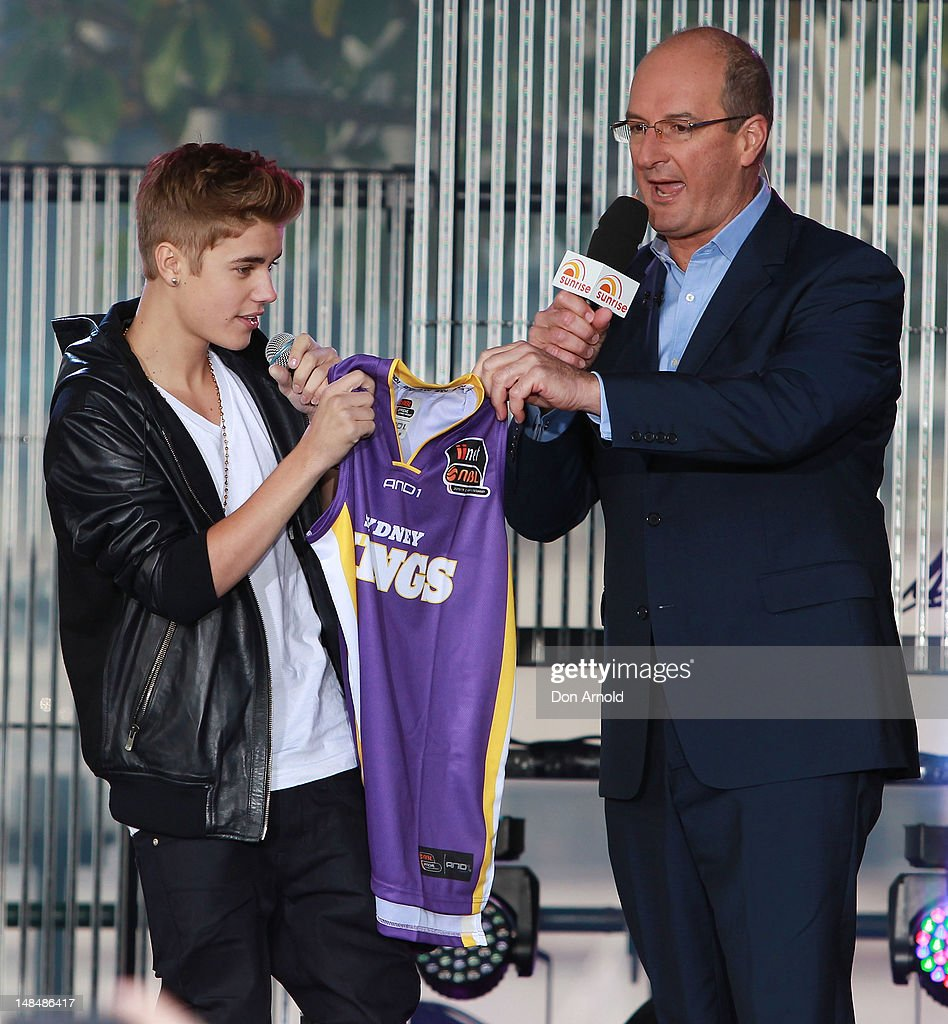 David Koch presents Justin Bieber with a Sydney Kings jersey during his performance on the Sunrise program at The Overseas Passenger Terminal on July 18, 2012 in Sydney, Australia.