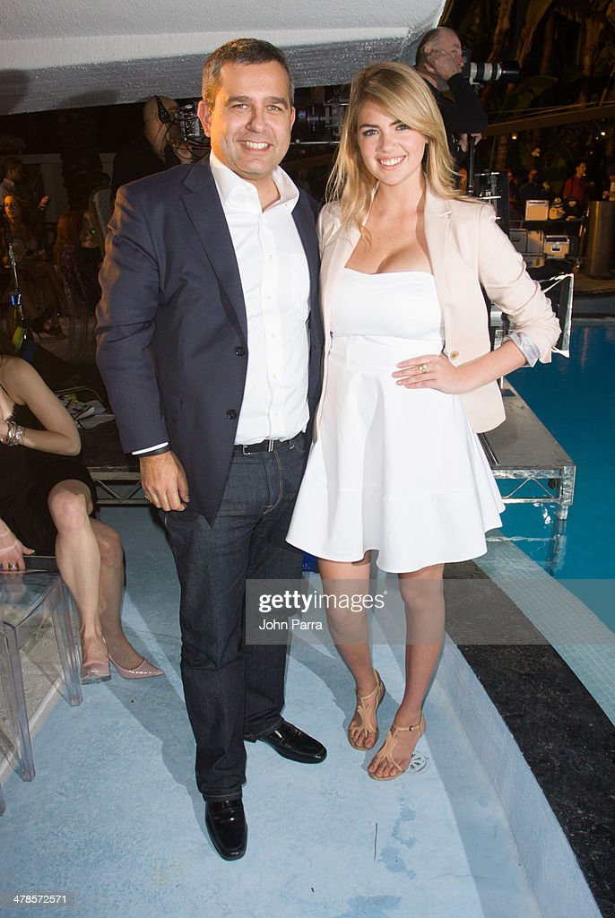 David Kornberg and <a gi-track='captionPersonalityLinkClicked' href=/galleries/search?phrase=Kate+Upton&family=editorial&specificpeople=7488546 ng-click='$event.stopPropagation()'>Kate Upton</a> attend the EXPRESS South Beach Runway Show at The Raleigh Hotel on March 13, 2014 in Miami, Florida.