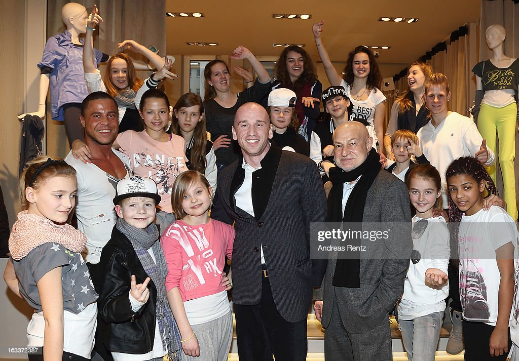 David Kramberg (3rd-R) of Dimensione Danza Deutschland poses with youth dance performers of D!'S dance school during the 'Dimensione Danza' - Berlin store opening on March 8, 2013 in Berlin, Germany.