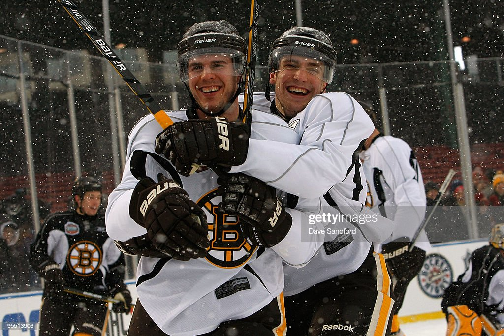 <a gi-track='captionPersonalityLinkClicked' href=/galleries/search?phrase=David+Krejci&family=editorial&specificpeople=722556 ng-click='$event.stopPropagation()'>David Krejci</a> #46 and Blake Wheeler #26 of the Boston Bruins joke around as they skate during practice prior to Bridgestone's presentation of 2010 NHL Winter Classic at Fenway Park on December 31, 2009 in Boston, Massachusetts.