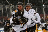 David Krejci and Blake Wheeler of the Boston Bruins joke around as they skate during practice prior to Bridgestone's presentation of 2010 NHL Winter...