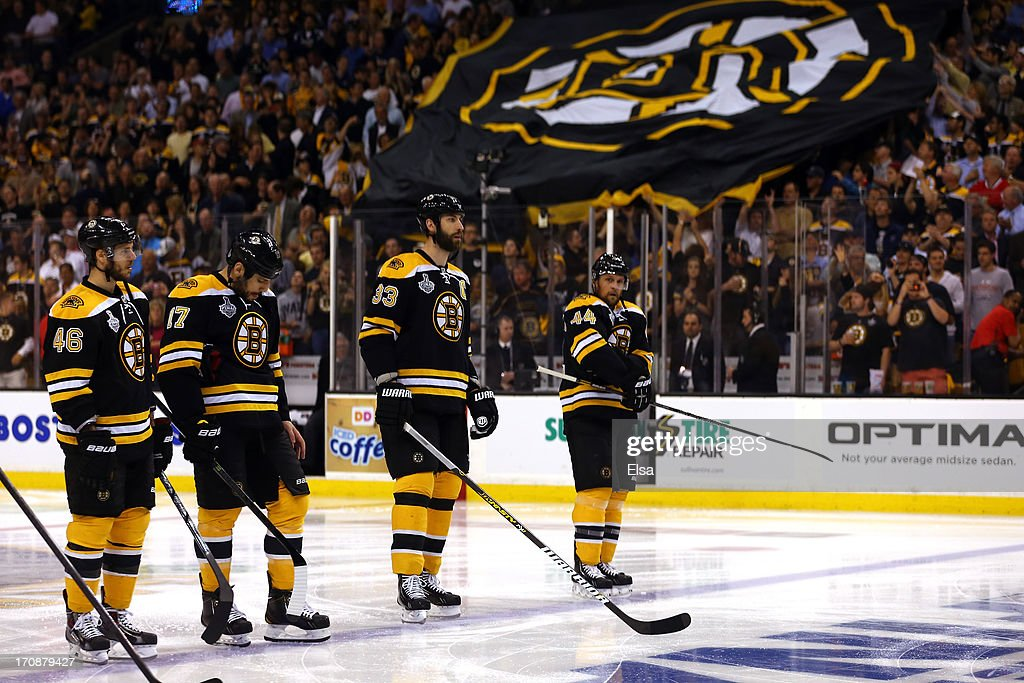 David Krejci #46, Milan Lucic #17, Zdeno Chara #33 and Dennis Seidenberg #44 of the Boston Bruins stand during the National Anthem prior to Game Four of the 2013 NHL Stanley Cup Final against the Chicago Blackhawks at TD Garden on June 19, 2013 in Boston, Massachusetts.