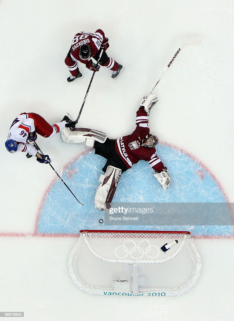 David Krejci of Czech Republic makes a shot on goal against goalkeeper Edgars Masalskis of Latvia during the ice hockey men's preliminary game...