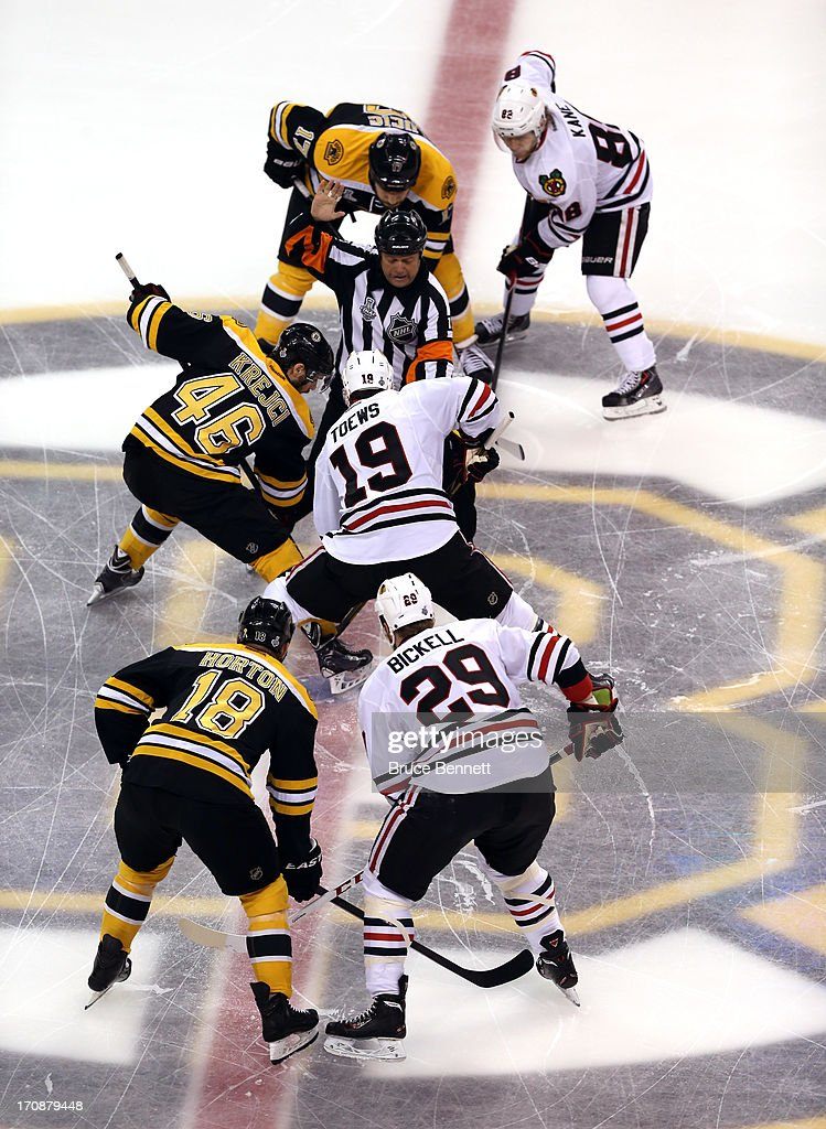 David Krejci #46 of the Boston Bruins and Jonathan Toews #19 of the Chicago Blackhawks face off to start Game Four of the 2013 NHL Stanley Cup Final at TD Garden on June 19, 2013 in Boston, Massachusetts.