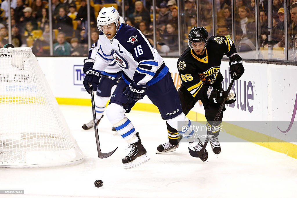 David Krejci #46 of the Boston Bruins attempts to chase down Andrew Ladd #16 of the Winnipeg Jets during the game on January 21, 2013 at TD Garden in Boston, Massachusetts.