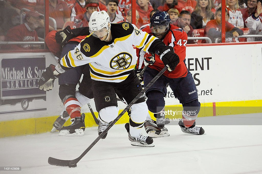<a gi-track='captionPersonalityLinkClicked' href=/galleries/search?phrase=David+Krejci&family=editorial&specificpeople=722556 ng-click='$event.stopPropagation()'>David Krejci</a> #46 of the Boston Bruins battles for the puck against the Joel Ward #42 of the Washington Capitals in Game Four of the Eastern Conference Quarterfinals during the 2012 NHL Stanley Cup Playoffs at Verizon Center on April 19, 2012 in Washington, DC.