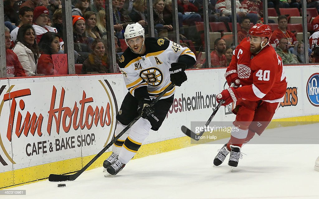 <a gi-track='captionPersonalityLinkClicked' href=/galleries/search?phrase=David+Krejci&family=editorial&specificpeople=722556 ng-click='$event.stopPropagation()'>David Krejci</a> #46 of the Boston Bruins carries the puck around the net as <a gi-track='captionPersonalityLinkClicked' href=/galleries/search?phrase=Henrik+Zetterberg&family=editorial&specificpeople=201520 ng-click='$event.stopPropagation()'>Henrik Zetterberg</a> #40 of the Detroit Red Wings gives chase during the third period of the game at Joe Louis Arena on November 27, 2013 in Detroit, Michigan. The Red Wings defeated the Bruins 6-1.