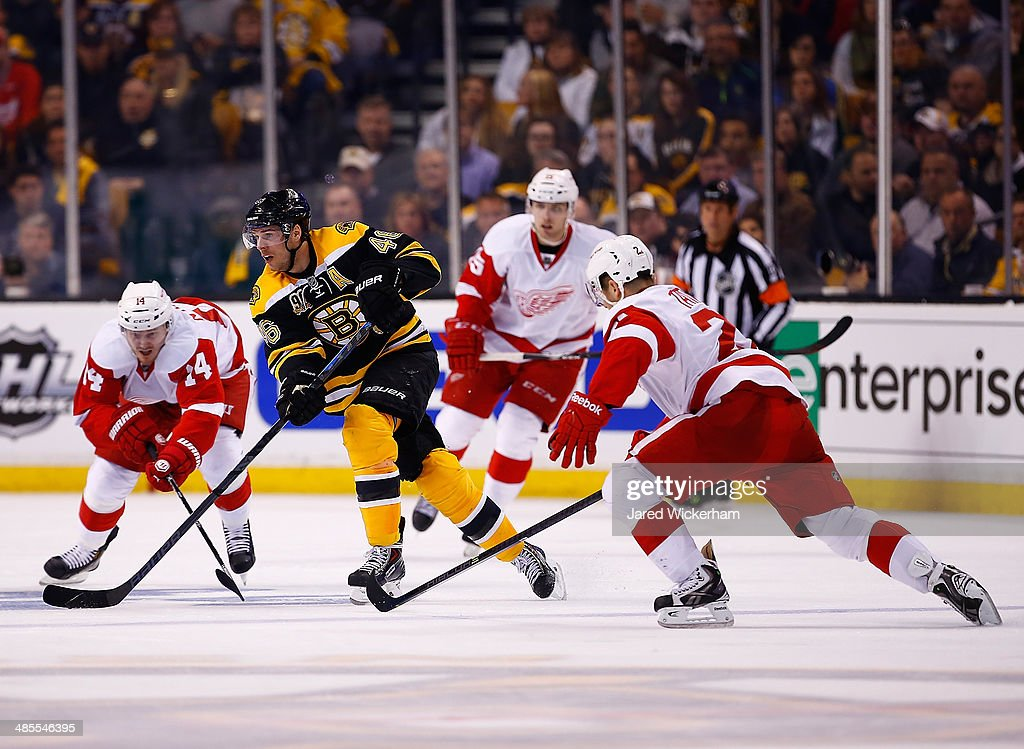 David Krejci #46 of the Boston Bruins carries the puck up the ice against the Detroit Red Wings in the third period in Game One of the First Round of the 2014 NHL Stanley Cup Playoffs at TD Garden on April 18, 2014 in Boston, Massachusetts.