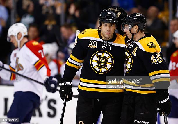 David Krejci of the Boston Bruins celebrates his emptynet goal in the third period to complete the hat trick with teammate Milan Lucic against the...