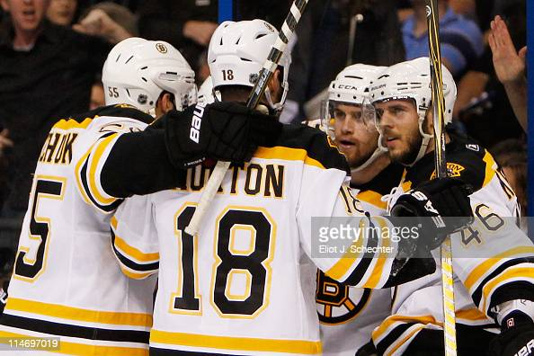 David Krejci of the Boston Bruins celebrates his first period goal with teammates in Game Six of the Eastern Conference Finals against the Tampa Bay...