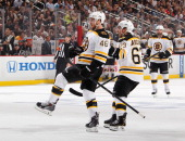 David Krejci of the Boston Bruins celebrates his goal with Brad Marchand during the first period against the Pittsburgh Penguins in Game One of the...