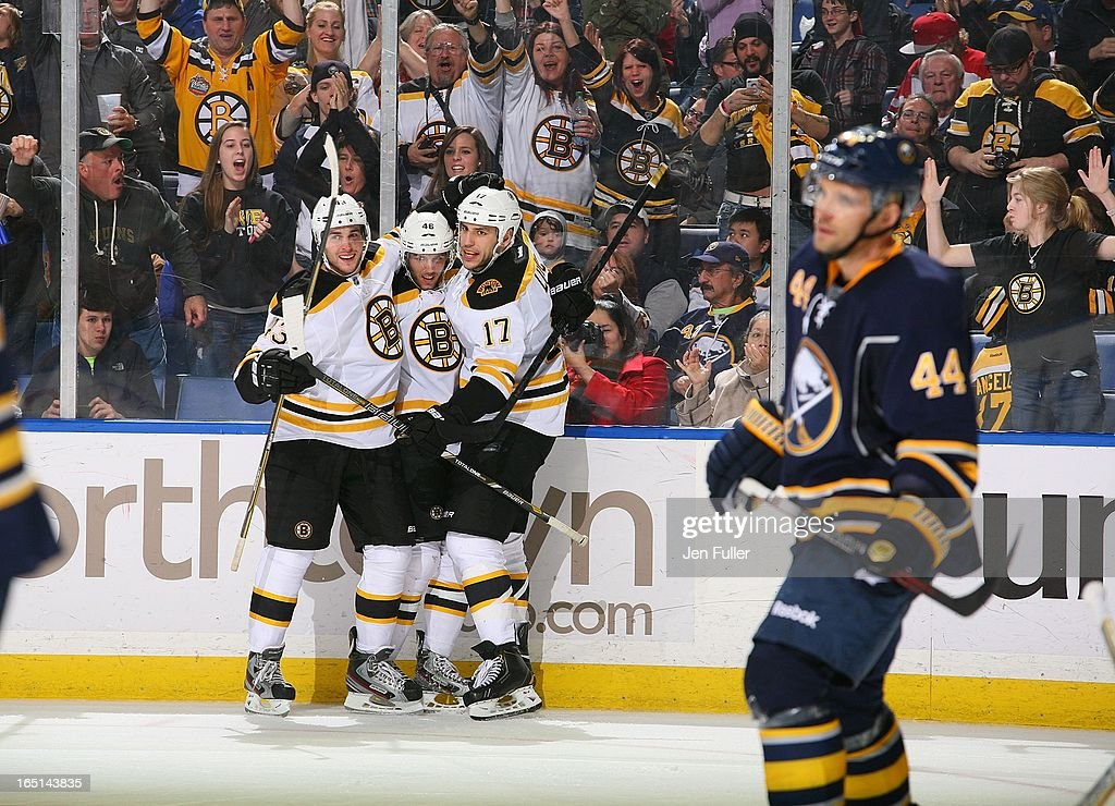 <a gi-track='captionPersonalityLinkClicked' href=/galleries/search?phrase=David+Krejci&family=editorial&specificpeople=722556 ng-click='$event.stopPropagation()'>David Krejci</a> #46 of the Boston Bruins celebrates his third period goal with teammates Matt Bartkowski #43 and <a gi-track='captionPersonalityLinkClicked' href=/galleries/search?phrase=Milan+Lucic&family=editorial&specificpeople=537957 ng-click='$event.stopPropagation()'>Milan Lucic</a> #17 as <a gi-track='captionPersonalityLinkClicked' href=/galleries/search?phrase=Andrej+Sekera&family=editorial&specificpeople=722503 ng-click='$event.stopPropagation()'>Andrej Sekera</a> #44 of the Buffalo Sabres skates by on March 31, 2013 at the First Niagara Center in Buffalo, New York. Boston defeated Buffalo, 2-0.