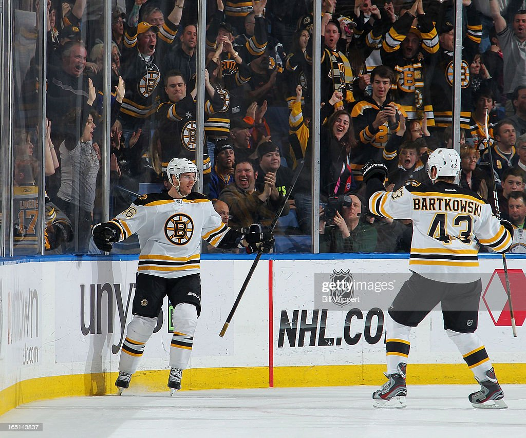 <a gi-track='captionPersonalityLinkClicked' href=/galleries/search?phrase=David+Krejci&family=editorial&specificpeople=722556 ng-click='$event.stopPropagation()'>David Krejci</a> #46 of the Boston Bruins celebrates his third period goal with teammate Matt Bartkowski #43 against the Buffalo Sabres on March 31, 2013 at the First Niagara Center in Buffalo, New York. Boston defeated Buffalo, 2-0.