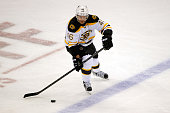 David Krejci of the Boston Bruins controls the puck against the Colorado Avalanche at Pepsi Center on October 14 2015 in Denver Colorado The Bruins...