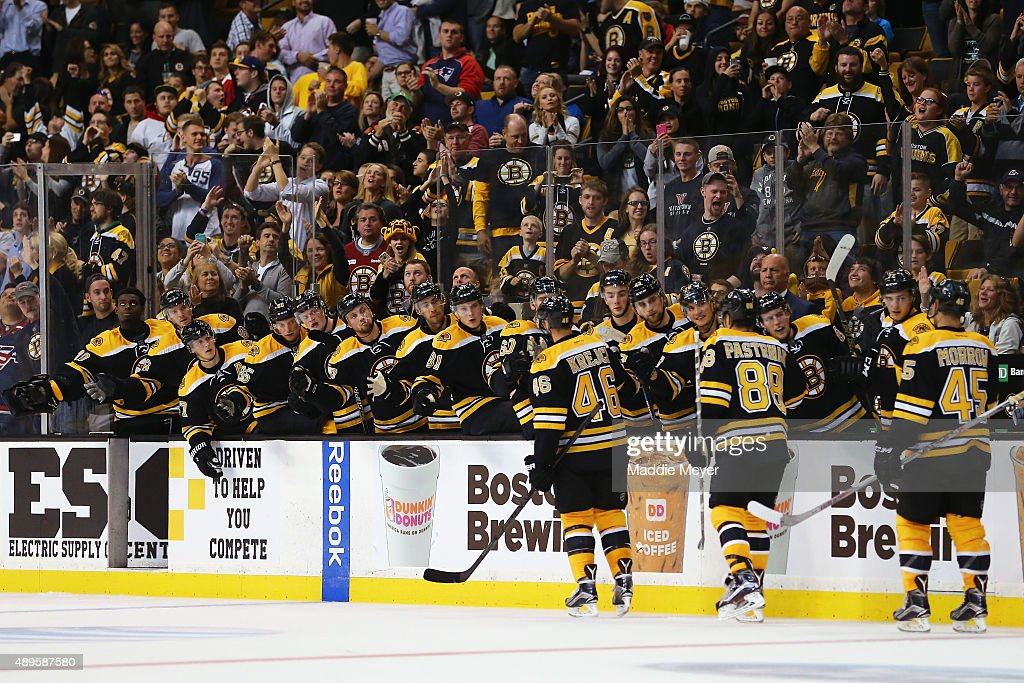 David Krejci #46 of the Boston Bruins, David Pastrnak #88 and Joe Morrow #45 celebrate with teammates after Pastrnak scored against the Washington Capitals during the third period at TD Garden on September 22, 2015 in Boston, Massachusetts. The Bruins defeat the Capitals 2-1 in overtime.