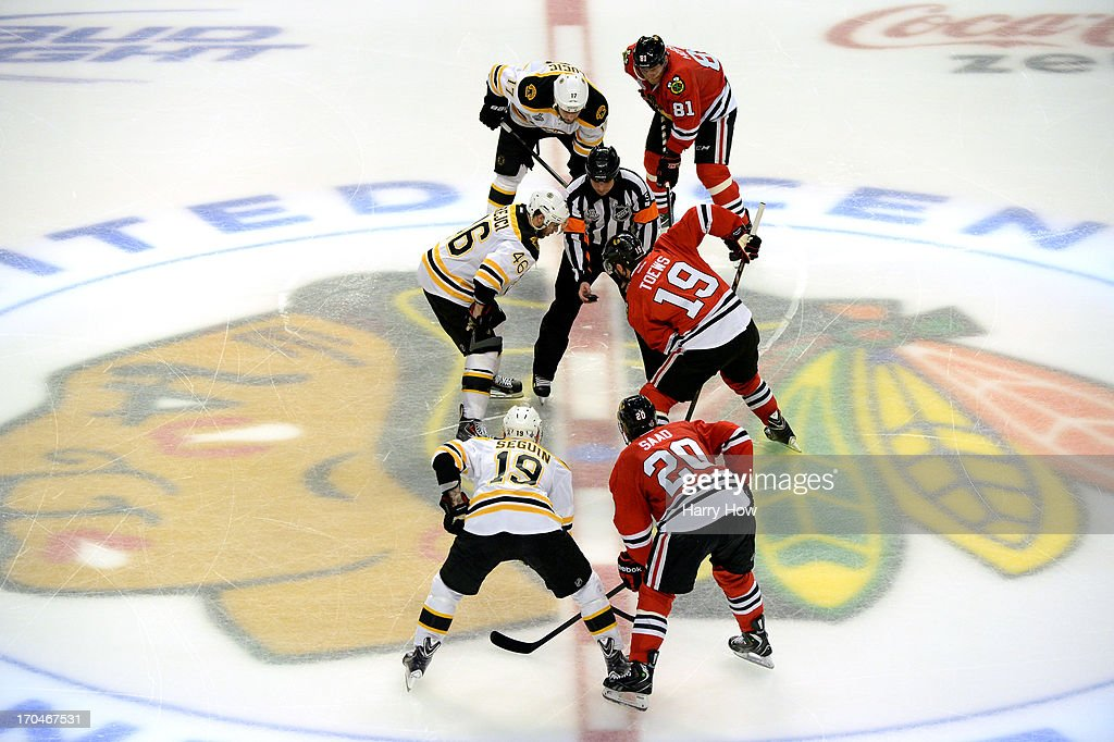 David Krejci #46 of the Boston Bruins faces off against Jonathan Toews #19 of the Chicago Blackhawks in Game One of the 2013 NHL Stanley Cup Final at United Center on June 12, 2013 in Chicago, Illinois.