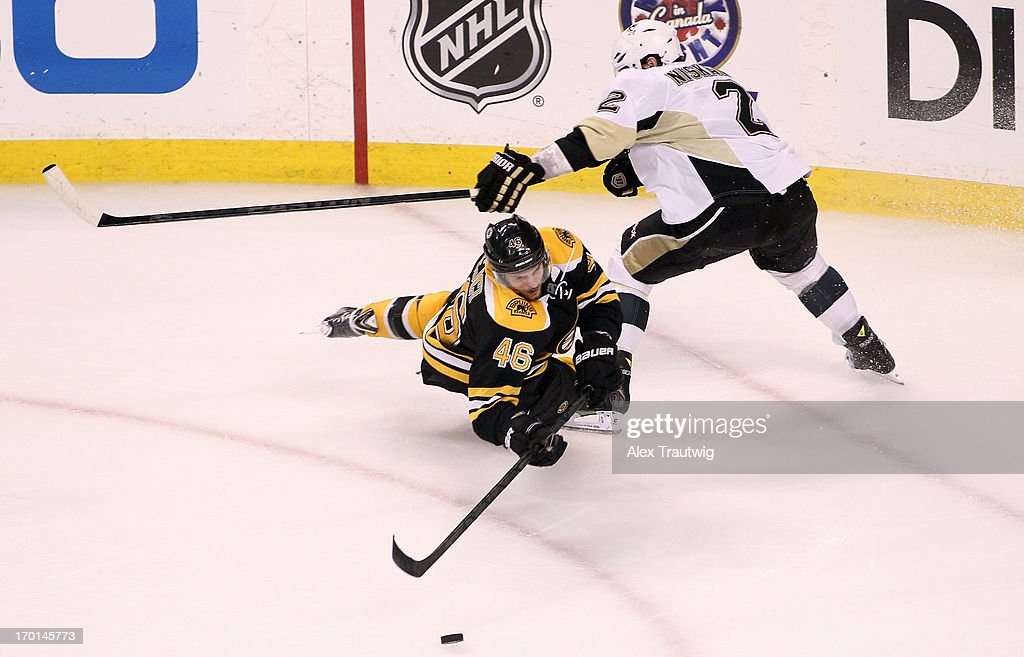 David Krejci #46 of the Boston Bruins handles the puck against Matt Niskanen #2 of the Pittsburgh Penguins in the third period in Game Four of the Eastern Conference Final during the 2013 Stanley Cup Playoffs at TD Garden on June 7, 2013 in Boston, Massachusetts.