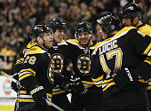 David Krejci of the Boston Bruins is congratulated by teammates Mark RecchiNathan HortonMilan Lucic and Zdeno Chara after Krejci scored a goal in the...
