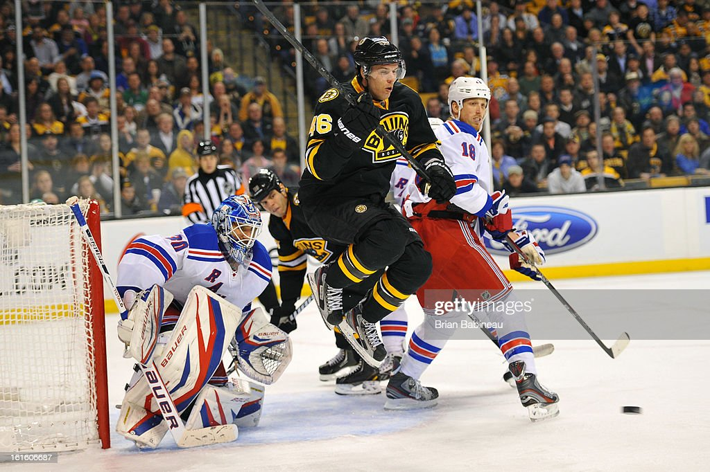 David Krejci #46 of the Boston Bruins jumps up to avoid the incoming puck against the New York Rangers at the TD Garden on February 12, 2013 in Boston, Massachusetts.