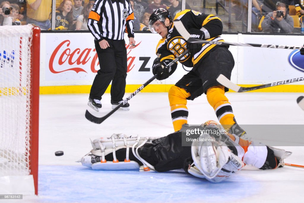 David Krejci of the Boston Bruins scores a goal against Brian Boucher of the Philadelphia Flyers in Game One of the Eastern Conference Semifinals...