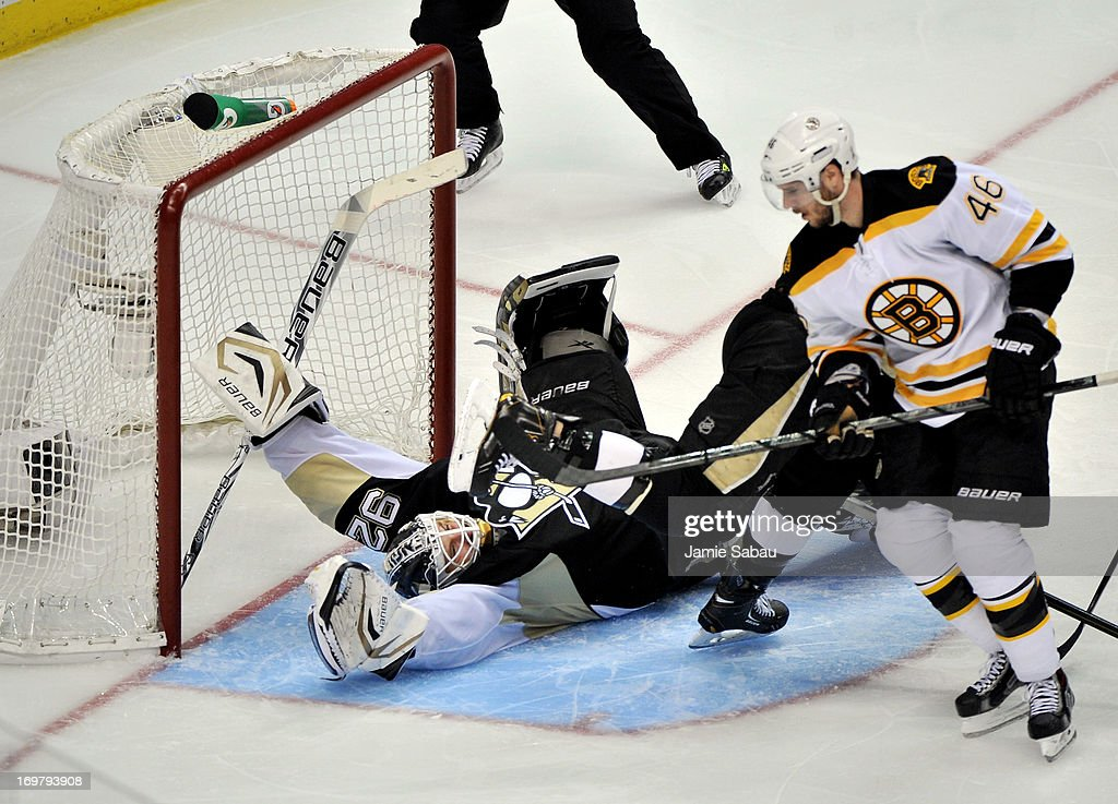 David Krejci of the Boston Bruins scores a goal on Tomas Vokoun of the Pittsburgh Penguins in the third period during Game One of the Eastern...