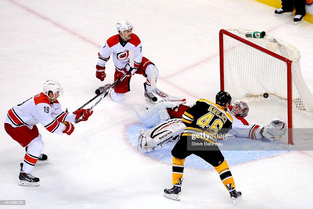 David Krejci of the Boston Bruins scores in overtime against the Carolina Hurricanes at the TD Garden on November 23 2013 in Boston Massachusetts