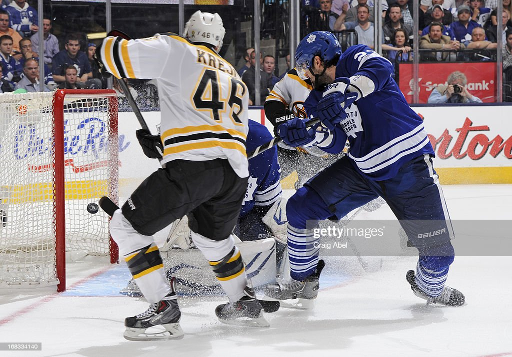 <a gi-track='captionPersonalityLinkClicked' href=/galleries/search?phrase=David+Krejci&family=editorial&specificpeople=722556 ng-click='$event.stopPropagation()'>David Krejci</a> #46 of the Boston Bruins scores in overtime as <a gi-track='captionPersonalityLinkClicked' href=/galleries/search?phrase=Ryan+O%27Byrne&family=editorial&specificpeople=3126048 ng-click='$event.stopPropagation()'>Ryan O'Byrne</a> #23 of the Toronto Maple Leafs defends in Game Four of the Eastern Conference Quarterfinals during the 2013 NHL Stanley Cup Playoffs May 8, 2013 at the Air Canada Centre in Toronto, Ontario, Canada.