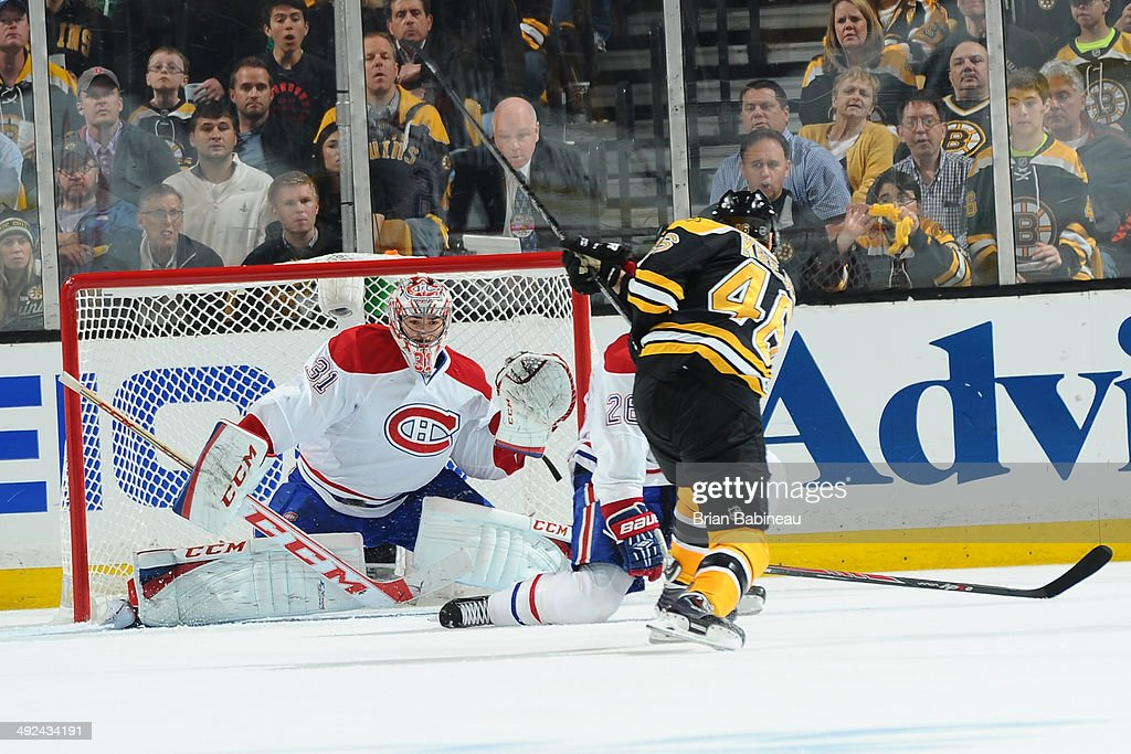 David Krejci #46 of the Boston Bruins shoots the puck against Carey Price #31 of the Montreal Canadiens in Game Seven of the Second Round of the 2014 Stanley Cup Playoffs at TD Garden on May 14, 2014 in Boston, Massachusetts.