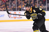 David Krejci of the Boston Bruins shoots the puck against the Detroit Red Wings at the TD Garden on November 14 2015 in Boston Massachusetts