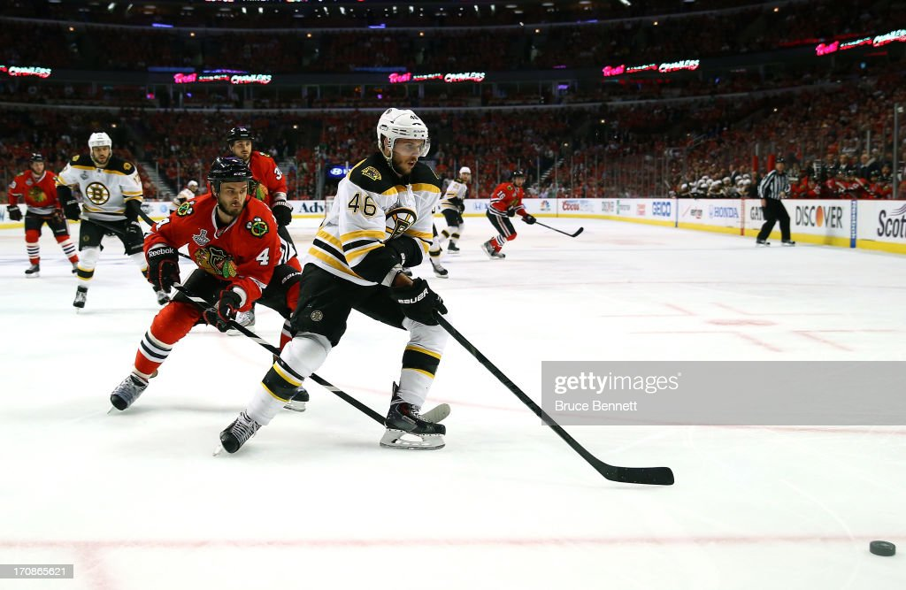 David Krejci #46 of the Boston Bruins skates after the puck against the Chicago Blackhawks in Game Two of the NHL 2013 Stanley Cup Final at United Center on June 15, 2013 in Chicago, Illinois. The Bruins won 2-1 in overtime.