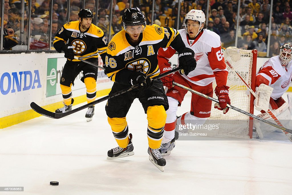 David Krejci #46 of the Boston Bruins skates against Danny DeKeyser #65 of the Detroit Red Wings in Game Five of the First Round of the 2014 Stanley Cup Playoffs at TD Garden on April 26, 2014 in Boston, Massachusetts.