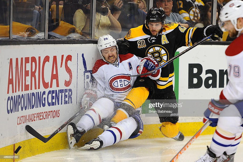 <a gi-track='captionPersonalityLinkClicked' href=/galleries/search?phrase=David+Krejci&family=editorial&specificpeople=722556 ng-click='$event.stopPropagation()'>David Krejci</a> #46 of the Boston Bruins skates against <a gi-track='captionPersonalityLinkClicked' href=/galleries/search?phrase=Josh+Gorges&family=editorial&specificpeople=550446 ng-click='$event.stopPropagation()'>Josh Gorges</a> #26 of the Montreal Canadiens in Game Five of the Second Round of the 2014 Stanley Cup Playoffs at TD Garden on May 10, 2014 in Boston, Massachusetts.