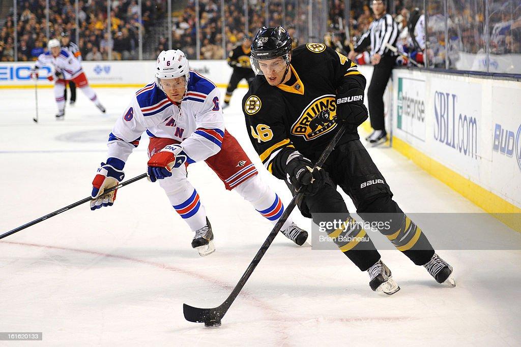 David Krejci #46 of the Boston Bruins skates with the puck against Anton Stralman #6 of the New York Rangers at the TD Garden on February 12, 2013 in Boston, Massachusetts.