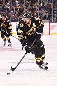 David Krejci of the Boston Bruins skates with the puck against the New Jersey Devils at the TD Garden on December 20 2015 in Boston Massachusetts