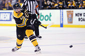 David Krejci of the Boston Bruins takes a shot on goal against the Florida Panthers during the first period at TD Garden on March 31 2015 in Boston...