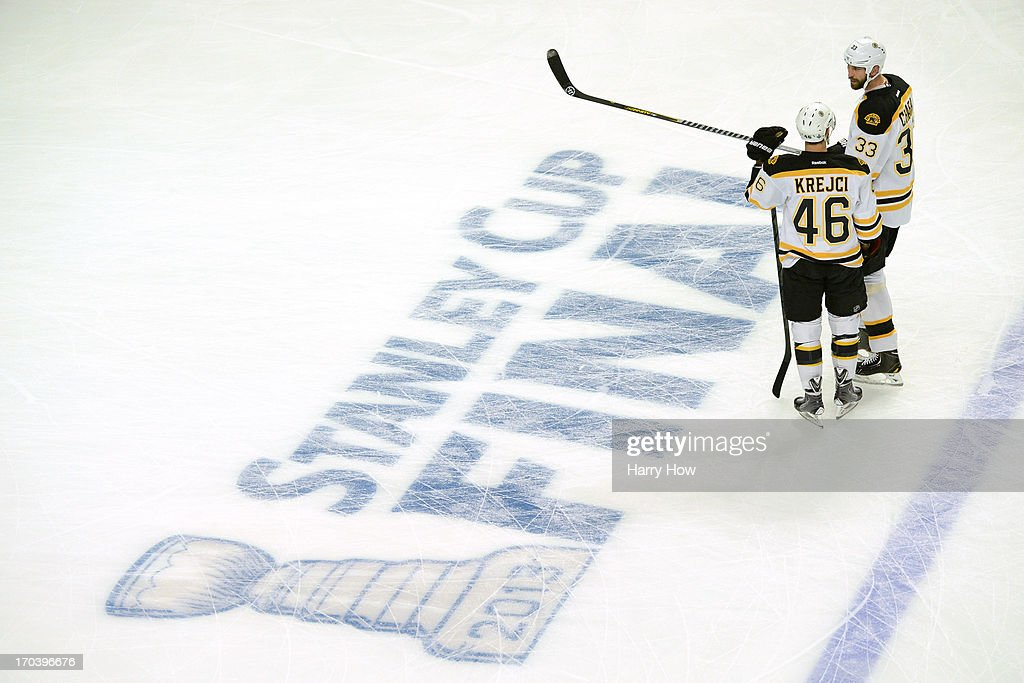 David Krejci of the Boston Bruins talks with teammate Zdeno Chara on the ice prior to Game One of the 2013 Stanley Cup Final against the Chicago...
