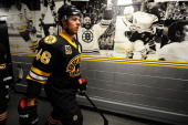 David Krejci of the Boston Bruins walks down the hallway before warm ups prior to the game against the Los Angeles Kings at the TD Garden on January...