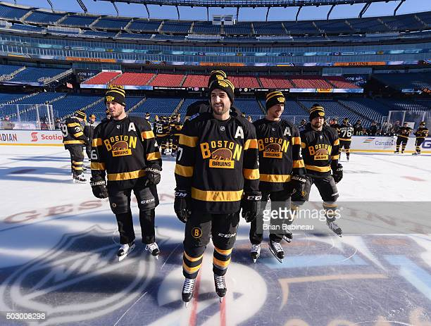 David Krejci Patrice Bergeron Chris Kelly and Dennis Seidenberg of the Boston Bruins take the ice for a team photo prior to team practice as part of...